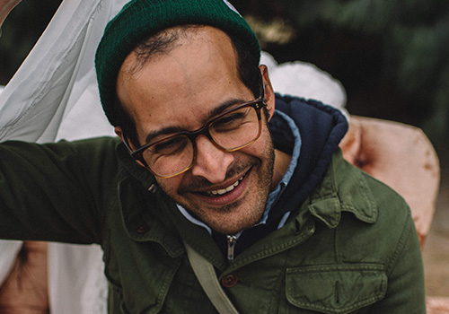 Happy Hour with Anis Mojgani – Presented by Literary Arts & Devil's Food Catering